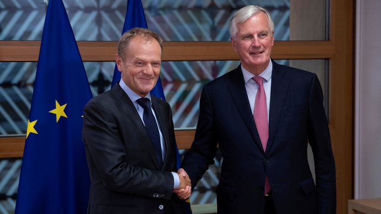 European Council President Donald Tusk poses with European Union's chief Brexit negotiator Michel Barnier ahead of a meeting in Brussels
