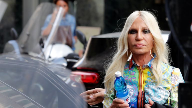 Donatella Versace, in classic Versace print, arriving to announce the news to employees in Milan