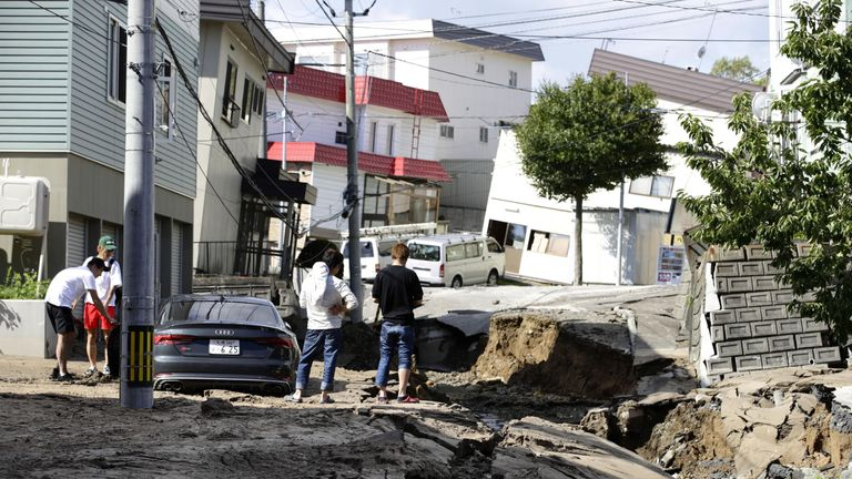People look at an area damaged by an earthquake in Sapporo in Japan's northern island of Hokkaido, Japan. Pic: Kyodo