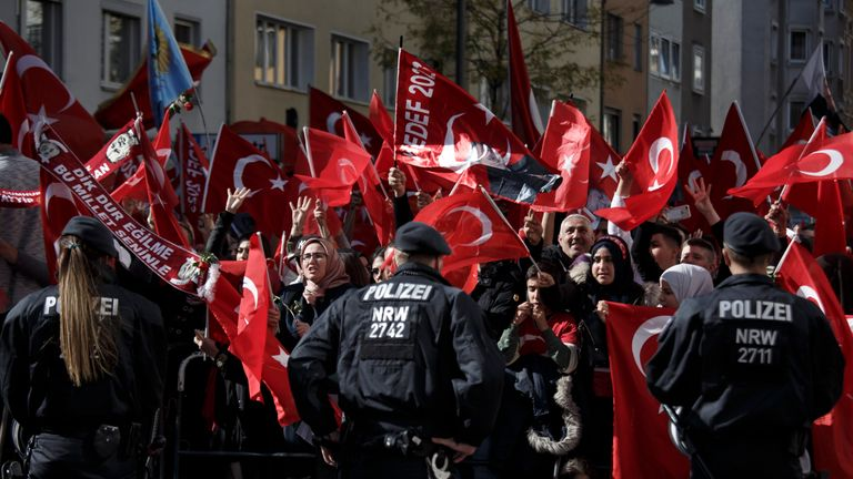 Supporters of Turkish President Recep Tayyip Erdogan stand near the new Ditib mosque prior to the arrival of Erdogan on September 29, 2018 in Cologne, Germany