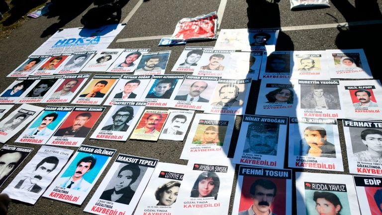 Photos of Turkish people who died in jail in Turkey lay on the ground during a demonstration in Cologne prior to the visit of the Turkish President to Cologne, where he is to inaugurate one of Europe's largest mosques, on September 29, 2018