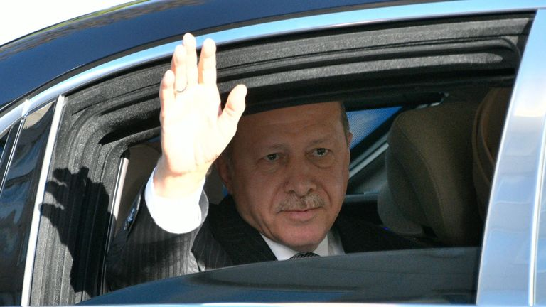 Turkish President Recep Tayyip Erdogan waves from his car as he arrives for the official opening of the newly built DITIB central mosque in Cologne, western Germany, on September 29, 2018