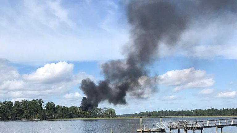 Smoke rises at the site of a F-35 jet crash in Beaufort, South Carolina