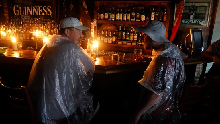 "People sit at a bar that has no power and drink during a ""Hurricane Party"" as Hurricane Florence comes ashore on Wilmington, North Carolina, U.S., September 14, 2018"