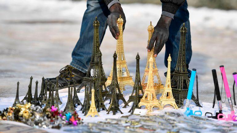 Migrants sell the mini Eiffel Towers around Paris tourist hotspots