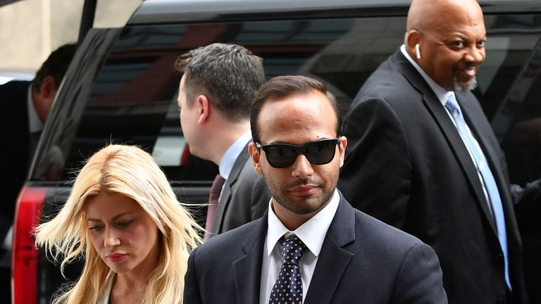 Former Trump Campaign aide George Papadopoulos arrives with his wife Simona Mangiante at district court