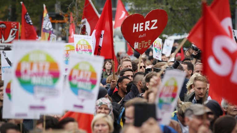 Some 3,500 marched in support of Ms Merkel's imigrant policy