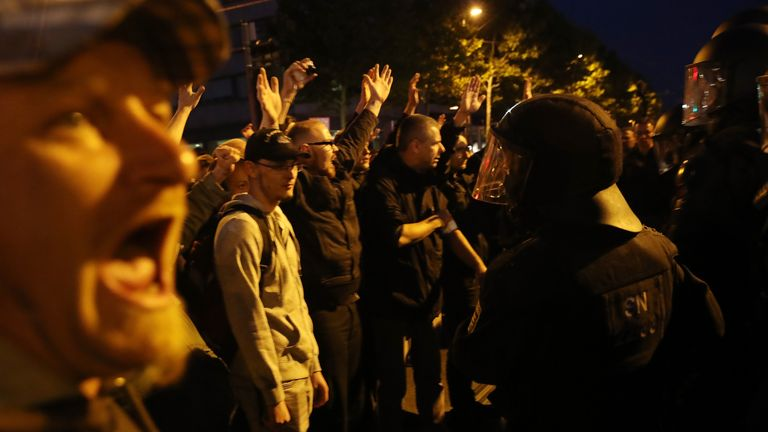 Far-right protesters shout and raise their arms in Chemnitz