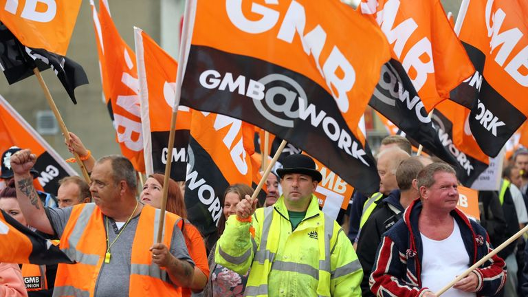 Public sector workers and members of the GMB union make their way through Brighton, as they take part in the one-day walkout as part of bitter disputes over pay, pensions, jobs and spending cuts.