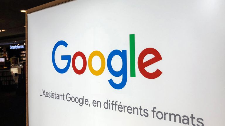 The logo of US multinational technology company Google with the subtitle in French 'Google Assistant in different formats' is seen at a store in Lille, northern France, on August 3, 2018. (Photo by DENIS CHARLET / AFP) (Photo credit should read DENIS CHARLET/AFP/Getty Images)