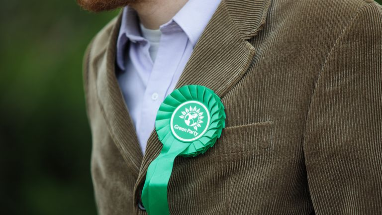 LONDON, ENGLAND - MAY 11: A Green Party rosette sits on the lapel of a supporter's corduroy jacket as Co-Leader of the Green Party Caroline Lucas launches the party's environmental manifesto at the Woodberry Wetlands nature reserve on May 11, 2017 in London, England. Campaigning is underway ahead of the June 8th general election. (Photo by Jack Taylor/Getty Images)