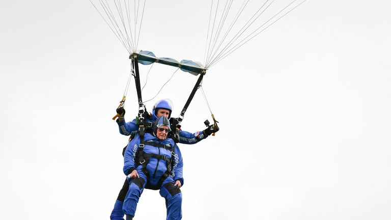 Harry Read descends under his parachute