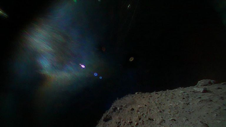 Taken immediately after separation from the spacecraft, this shows Hayabusa2 is at the top and the surface of Ryugu is bottom.