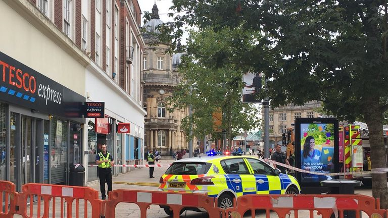 Santander and Barclays Bank in Queen Victoria Square were cordoned off by officers. Pic: Viking FM News