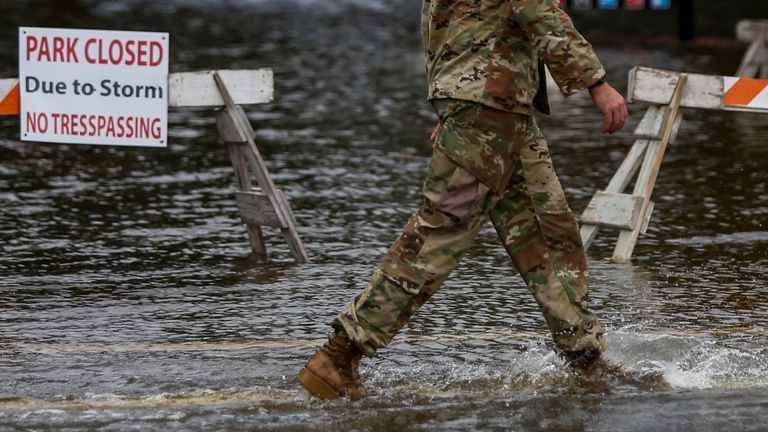 A member of the U.S. Army walks through floodwaters near the Union Point Park Complex as Hurricane Florence comes ashore in New Bern, North Carolina