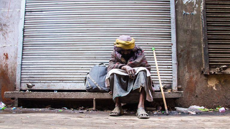 Homeless man in Old Delhi, India