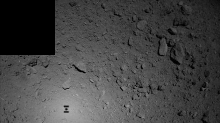 The probe can be seen as a shadow on the asteroid