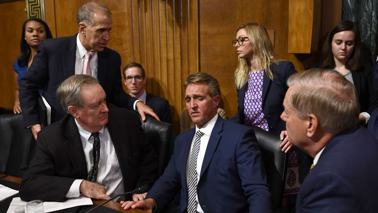 Senate Judiciary Committee member Senator Jeff Flake (R-AZ) speaks with committee colleagues during a hearing on Capitol Hill in Washington, DC on September 28, 2018
