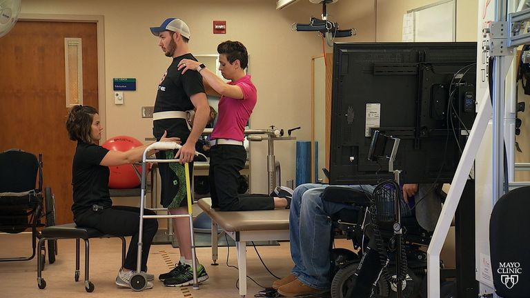 Jered Chinnock standing, despite being paralysed, with the help of a new technology. Pic: Mayo Clinic