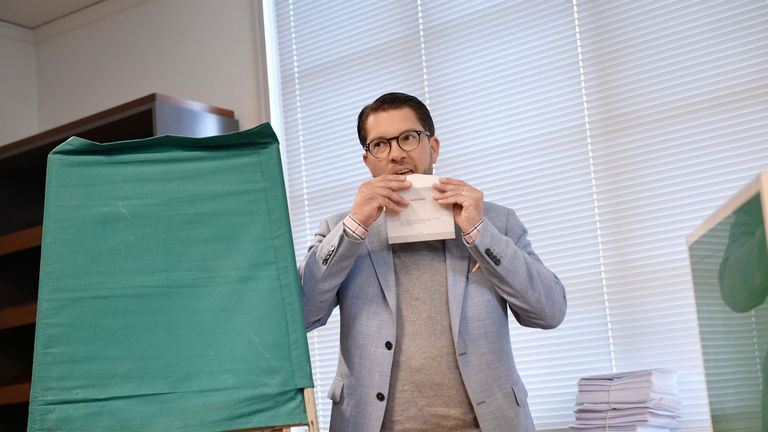 Leader of the Sweden Democrats, Jimmie Akesson, seals his ballot at a polling station in Stockholm