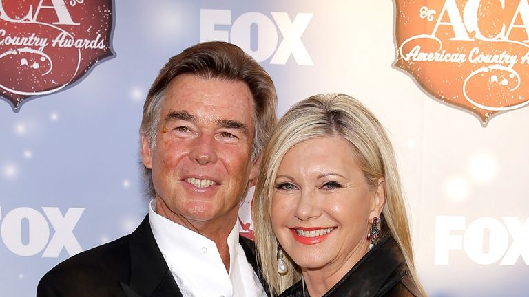 John Easterling and actress Olivia Newton-John arrive at the American Country Awards 2013 at the Mandalay Bay Events Center on December 10, 2013 in Las Vegas, Nevada