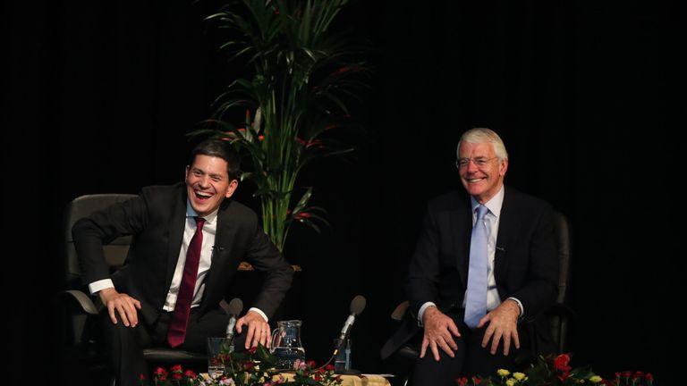 Sir John Major (right) and David Miliband