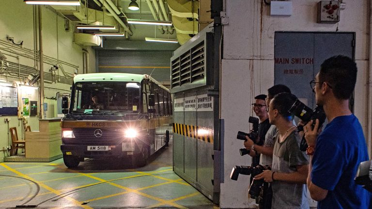 A prison van transporting Malaysian national Khaw Kim-sun, 53, who is accused of murdering his wife and daughter, leaves the High Court in Hong Kong