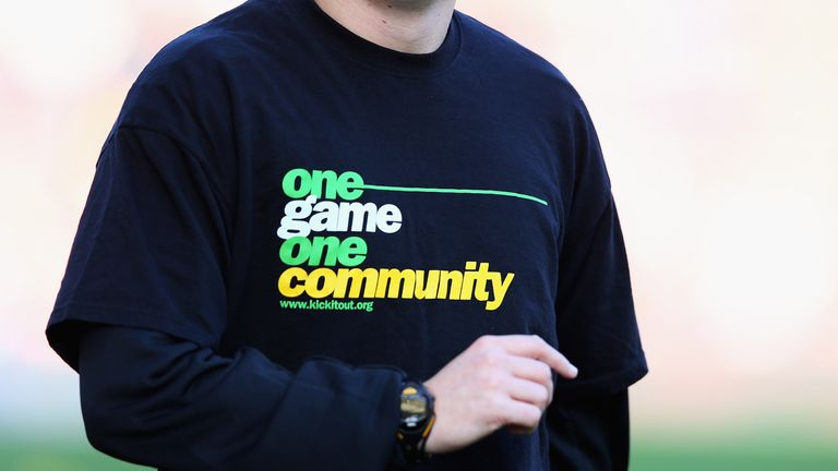 A player wears a 'Kick it out' T-shirt ahead of the Barclays Premier League
