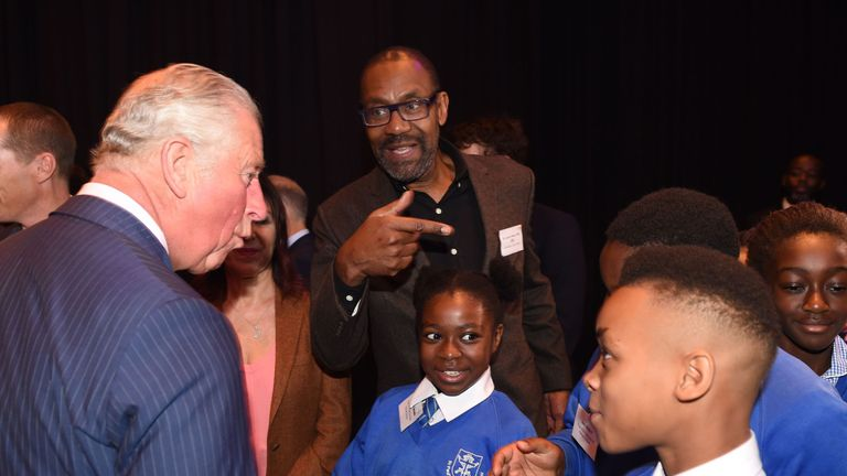 Britain's Prince Charles, Prince of Wales (L) meets British actor Lenny Henry (C) and school children as he attends an event to promote the arts in schools at the Royal Albert Hall in London on September 5, 2018