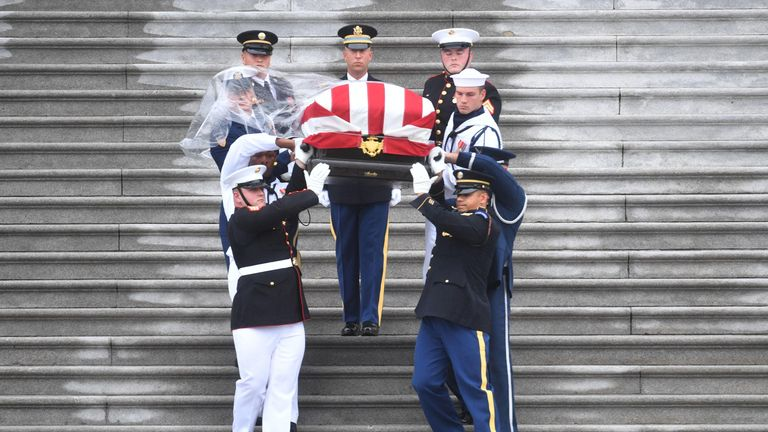 A Military Honour Guard carries Senator McCain's coffin