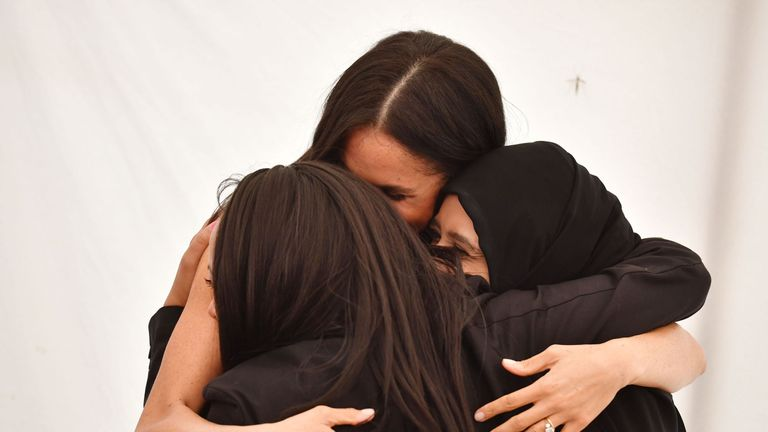 The duchess hugged two of the women involved in the project