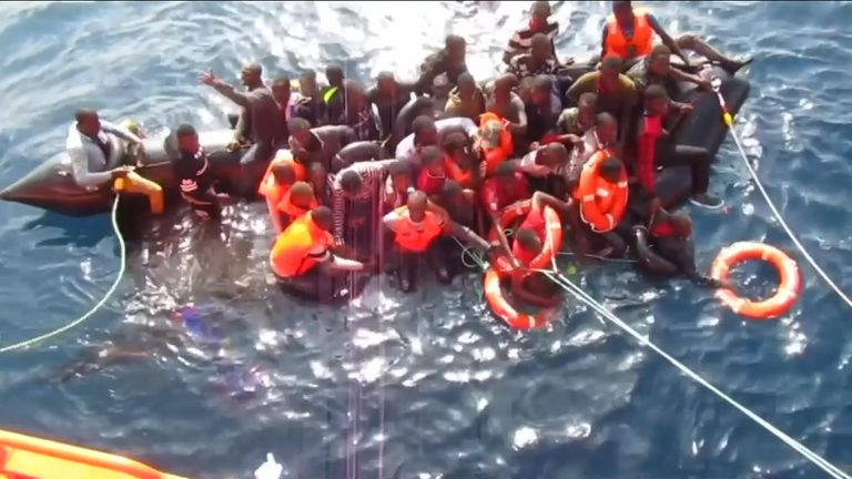 Migrants rescued from sinking dinghy