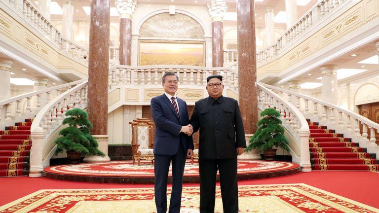 South Korean President Moon Jae-in shakes hands with North Korean leader Kim Jong Un in Pyongyang, North Korea