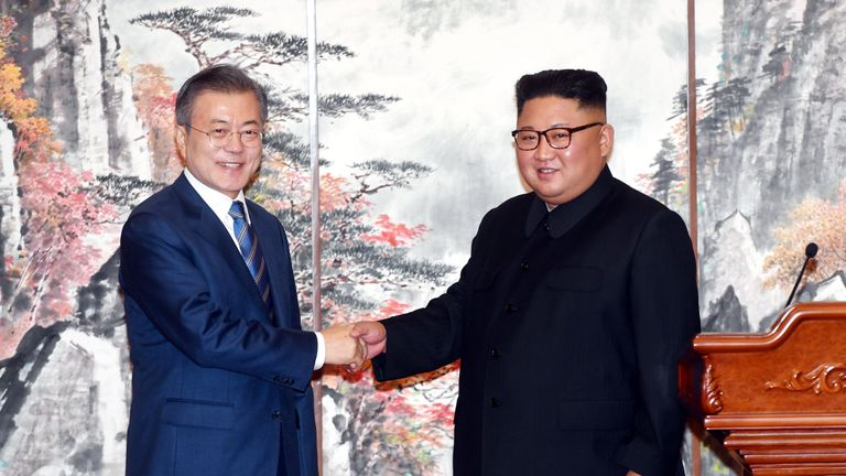 South Korean President Moon Jae-in shakes hands with North Korean leader Kim Jong Un during a joint news conference in Pyongyang, North Korea