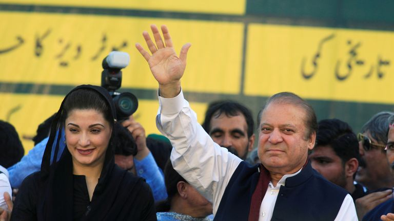 Nawaz Sharif (R), former Prime Minister and leader of Pakistan Muslim League, gestures to supporters as his daughter Maryam Nawaz looks on during party's workers convention in Islamabad, Pakistan June 4, 2018. REUTERS/Faisal Mahmood