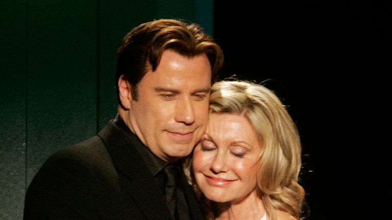 "Australian singer and actress Olivia Newton-John hugs actor John Travolta after he presented her the Lifetime Achievement award at the Penfolds Icon Gala Dinner during G' Day LA Australia Week 2006 in Hollywood January 14, 2006. Travolta starred with Newton-John in the movie ""Grease."" REUTERS/Fred Prouser"