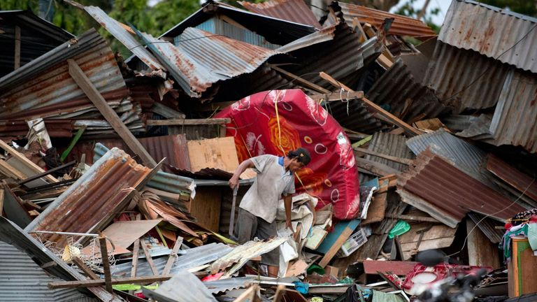 A man pictured at his destroyed house in Palu, Indonesia