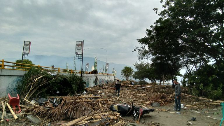 Residents examine the tsunami aftermath in Palu