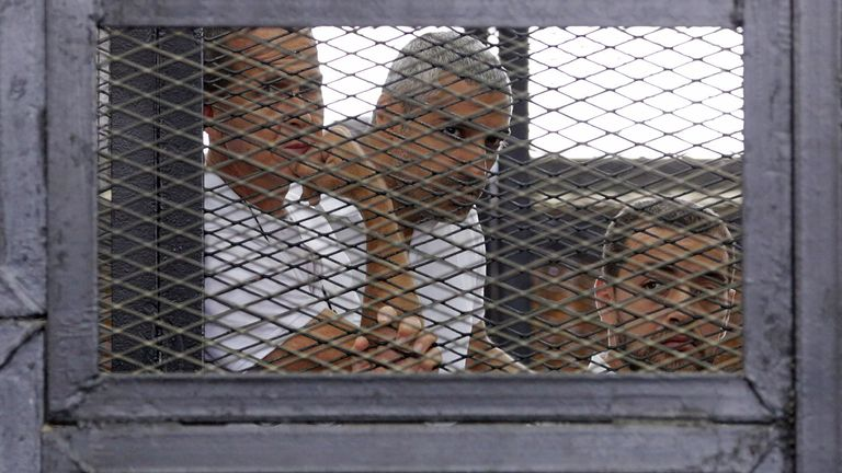 Peter Greste, Mohamed Fahmy and Baher Mohamed appear in court in Egypt