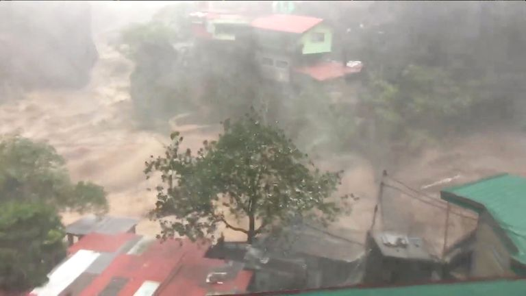 Raging floods water is seen in Baguio City as Typhoon Mangkhut, known locally as Ompong, hit the Philippines