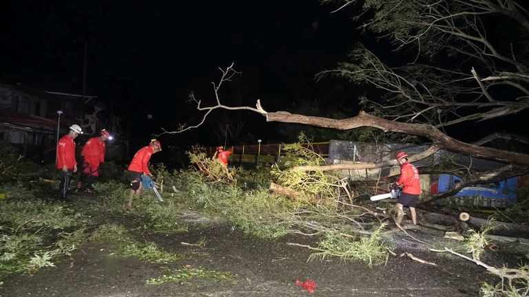Philippines Red Cross teams have been clearing debris from the road