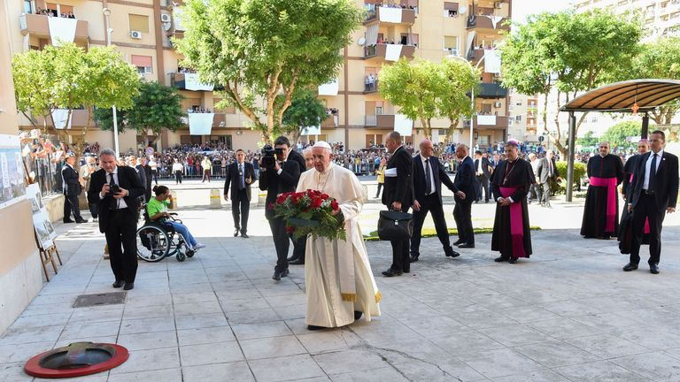 The Pope laid flowers at the spot where Father Puglisi was shot dead