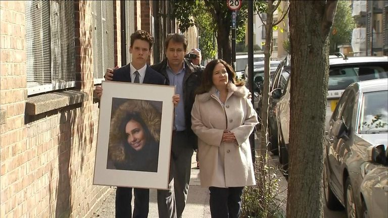 Natasha's family held a picture of her as they spoke to the media