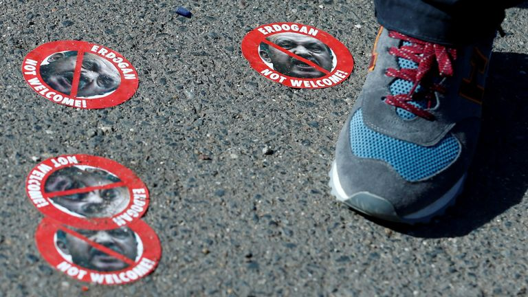 'Erdogan not welcome' stickers are seen on the floor in Cologne