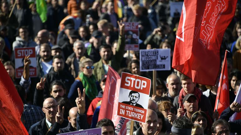 Demonstrators waved placards saying: 'Refugees welcome, Erdogan not welcome'