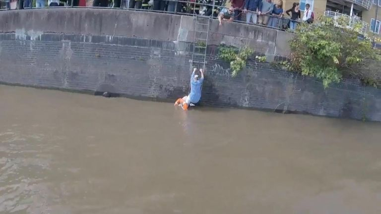 The Chiswick Lifeboat team rescued a woman and her dog, found clinging to a ladder up the wall of the river Thames.