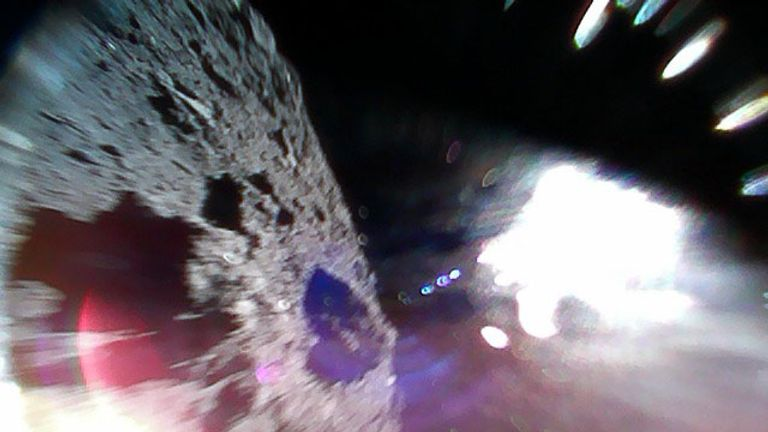 Rover-1A lands on the asteroid surface, right