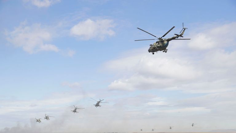 """Military helicopters fly over the training ground """"Tsugol"""""""