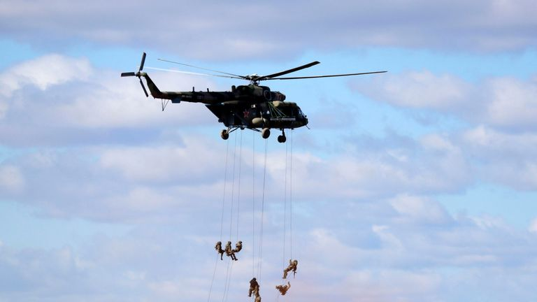 """Soldiers abseil from a military helicopter over the training ground """"Tsugol"""""""