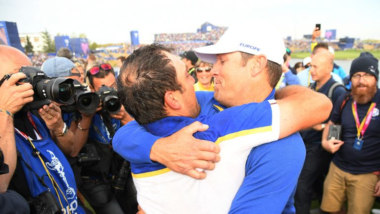 Francesco Molinari is hugged by team captain Thomas Bjorn after sealing Europe's Ryder Cup victory